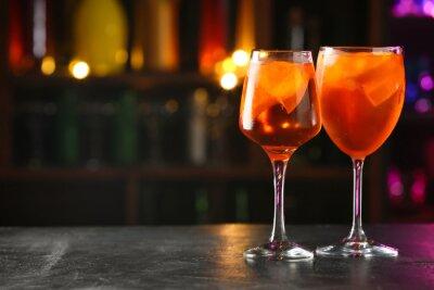 Plakat Glasses of tasty aperol spritz cocktail on table