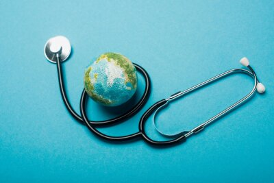 Plakat Globe and stethoscope on blue background, world health day concept
