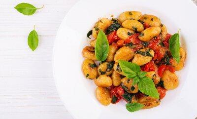 Gnocchi pasta in rustic style.  Italian cuisine. Vegetarian vegetable pasta. Cooking lunch. Gourmet dish. Top view