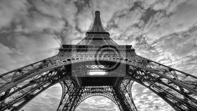 Plakat Grayscale low angle shot of the historic Eiffel tower under the gloomy sky