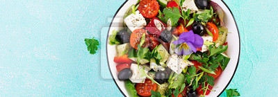 Greek salad  with cucumber, tomato, sweet pepper, lettuce, green onion, feta cheese and olives with olive oil. Healthy food. Top view