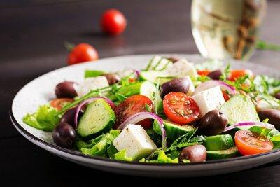 Greek salad with fresh vegetables, feta cheese and kalamata olives. Healthy food.