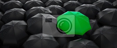 Plakat Green umbrella stand out from the crowd of many black umbrellas - being different concept