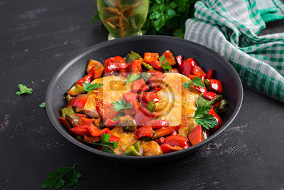 Grilled chicken fillets and sweet pepper on grill iron pan.