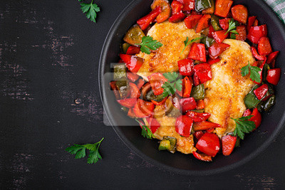 Grilled chicken fillets and sweet pepper on grill iron pan. Top view, copy space