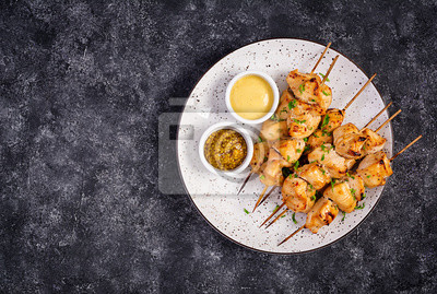 Grilled chicken kebab on a dark background.Copy space. Top view