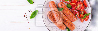 Grilled sausage with tomatoes, basil salad and red onions. BBQ menu. Banner. Top view