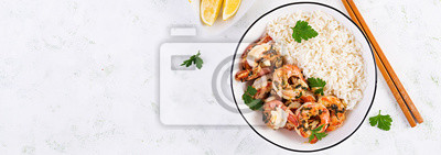 Grilled shrimps and boiled rice. King prawn tails in orange-garlic sauce with parsley. Top view, banner