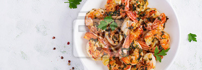 Grilled shrimps. King prawn tails in orange-garlic sauce with parsley. Top view, banner