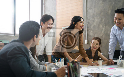 Plakat Group of Asian business people team meeting in modern office working design planning and ideas concept