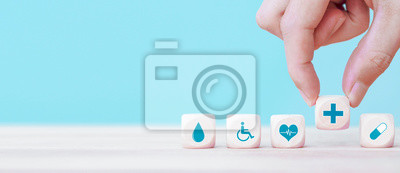 Plakat Hand chooses a emoticon icons healthcare medical symbol on wooden block , Healthcare and medical Insurance concept