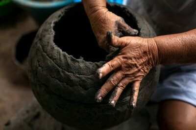 Plakat Hands of women craftsmen making clay vessels. These women are cultural living heritage of the fishing community of Manicuare in Venezuela.