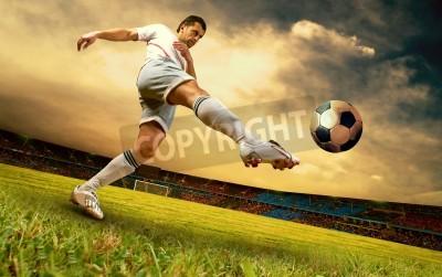 Plakat Happiness football player on field of olimpic stadium on sunrise sky