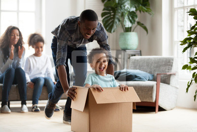 Plakat Happy black family play with kids moving to new home
