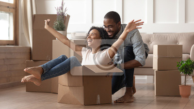 Plakat Happy black young couple have fun on moving day