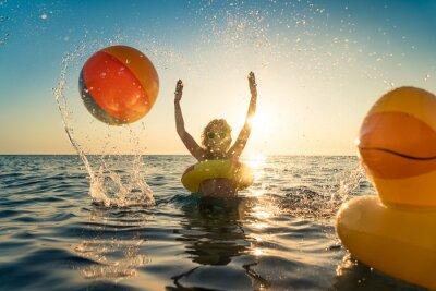 Plakat Happy child having fun on summer vacation