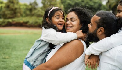 Plakat Happy indian family having fun outdoor - Hindu parents laughing with their children at city park - Love concept - Main focus on mother and daughter face