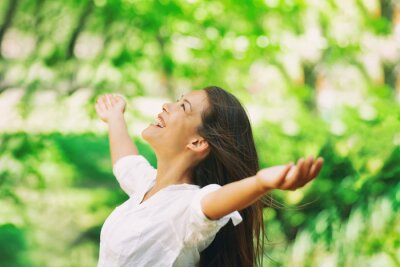 Plakat Happy woman breathing fresh clean air outdoor nature forest for spring season pollen allergies. Carefree Asian girl with arms outstretched in freedom. Happiness outside.