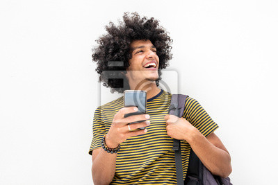 Plakat happy young guy with bag and cellphone smiling on isolated white background