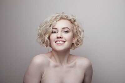 Plakat Headshot of gorgeous attractive young lady with curly hair smiling. Marilyn Monroe