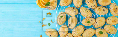 Homemade cookies. French cookies Madeleines with orange juice and chocolate chips. Banner. Top view