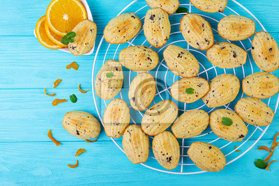 Homemade cookies. French cookies Madeleines with orange juice and chocolate chips. Top view