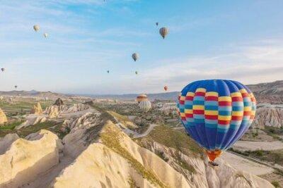 Plakat Hot air balloon flying over Cappadocia region, Turkey