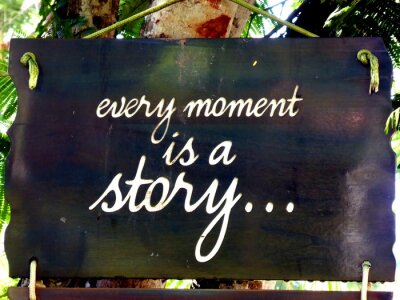 Plakat Inspirational motivation quote Every moment is a story on a sigh hanging in tree
