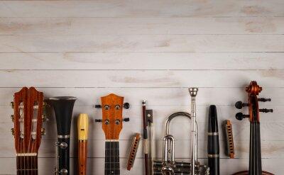 Plakat instruments in white wooden background