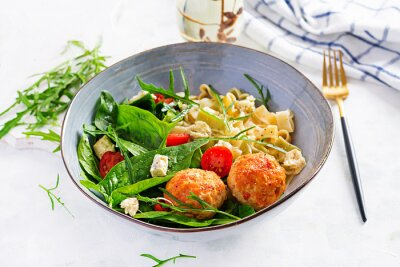 Italian pasta. Pasta  with meatballs,  cheese and fresh salad on light background. Dinner. Top view, overhead. Slow food concept