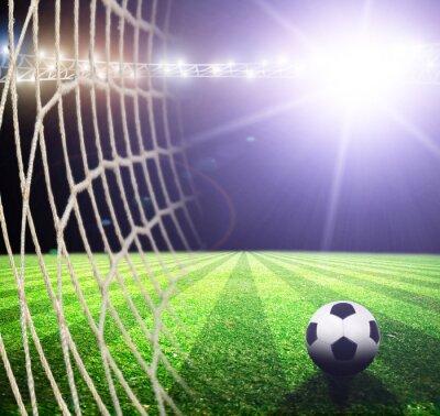 Plakat Jasne światła w nocy i stadionu piłkarskiego