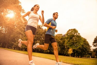 Plakat Jogging together - sport young couple