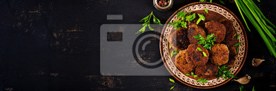 Juicy delicious meat cutlets on a dark table. Russian cuisine. Banner.  Top view