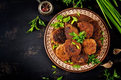 Juicy delicious meat cutlets on a dark table. Russian cuisine. Top view