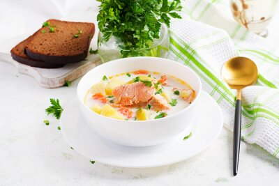 Kalakeitto. Creamy soup with salmon, potatoes, onions and carrots and  in a bowl. Finnish/ karelian cuisine. Lohikeitto