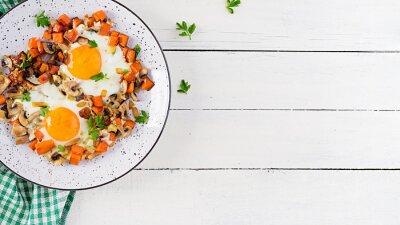 Ketogenic food. Fried egg, mushrooms and sliced pumpkin. Keto, paleo breakfast. Top view, overhead, copy space