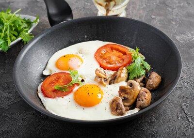 Ketogenic food. Fried egg, mushrooms and sliced tomatoes. Keto, paleo breakfast.