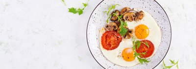 Ketogenic food. Fried egg, mushrooms and sliced tomatoes. Keto, paleo breakfast. Top view, overhead, banner