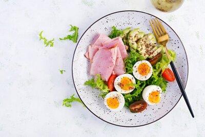 Ketogenic/paleo diet. Boiled eggs, ham, avocado and fresh salad.  Keto breakfast. Brunch.  Top view, overhead