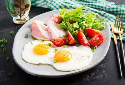 Ketogenic/paleo diet. Fried eggs, ham and fresh salad.  Keto breakfast. Brunch.