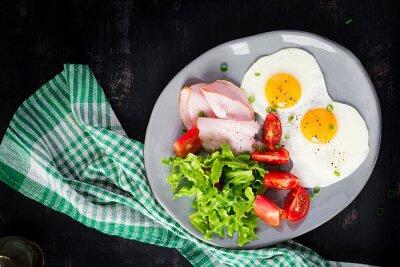 Ketogenic/paleo diet. Fried eggs, ham and fresh salad.  Keto breakfast. Brunch.  Top view, overhead