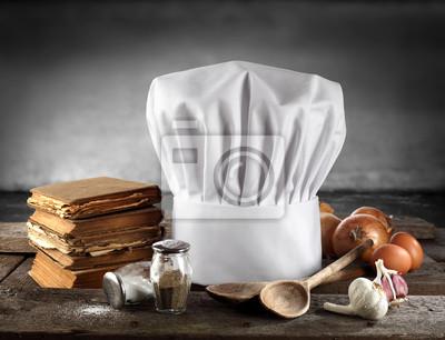 książki do gotowania i białe czapki