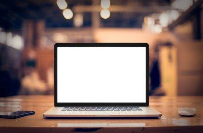 Plakat Laptop z pustego ekranu na stole.