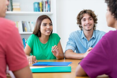 Plakat Latin and caucasian male and female students learning for exam