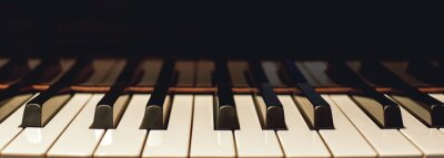 Plakat Learn how to play piano. Close up view of black and white piano keys. Musical instrument