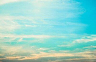Plakat Light blue sky background with tiny fluffy clouds