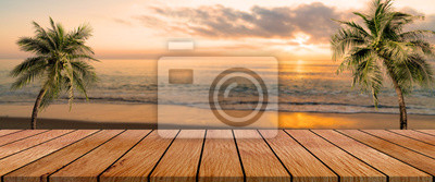 Plakat long wooden table with beach landscape blur background