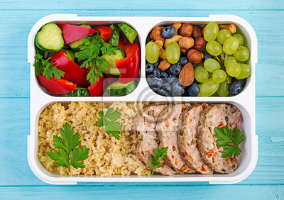 Lunch box  meatloaf, bulgur, nuts, cucumber  and berry. Healthy fitness food. Take away. Lunchbox. Top view
