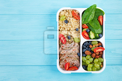 Lunch box  meatloaf, bulgur, nuts, tomato  and berry. Healthy fitness food. Take away. Lunchbox. Top view