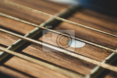 Plakat Macro close up shot of acoustic guitar strings on sun shine. Music and guitar playing concept